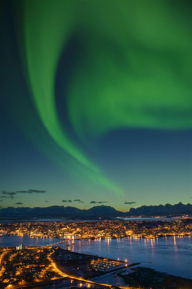The Northern Lights Aurora Borealis In Arctic Norway